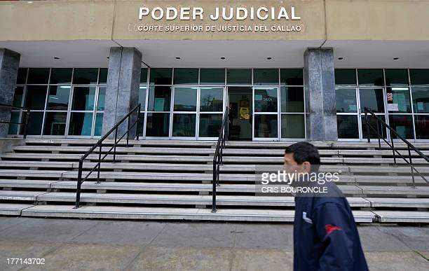 A man passes in front of the Courthouse of Callao where 19yearold Briton Melissa Reid and 20yearold Irishwoman Michaella McCollum Connolly appeared...