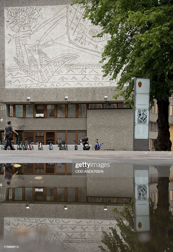 A man passes Picasso's mural art work 'The Fisherman' on the government quarter's 'Y building' in Oslo, Norway on August 6, 2013. The art work survived the 22nd July 2011 bombing unscathed, but other government buildings bearing the artist's murals were severely damaged. The Norwegian Directorate for Cultural Heritage fears that Picasso's first monumental concrete murals, which were made between the late 1950s and the early 1970s for two government buildings in Oslo, may be destroyed. The buildings were severely damaged during the deadly terrorist attack in the Norwegian capital in July 2011. The government is now considering whether to demolish the Modernist buildings that form the regjeringskvartal or government quarter. AFP PHOTO / ODD ANDERSEN