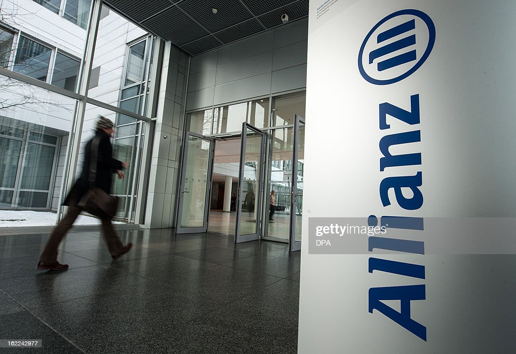 A man passes the logo of German Allianz insurance company at the company's headquarter in Munich, southern Germany, on February 21, 2013. German insurance giant Allianz said Thursday, February 21, 2013 that its net profit more than doubled last year as it shrugged off the worst of the financial crisis.
