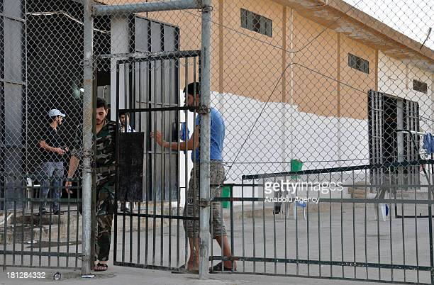 A man passing through a door of the prison in Aleppo on August 21 2013 in AleppoSyria The Aleppo prison in the Al Ray building where about 50...