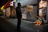 A man pauses at an makeshift memorial for Eric Garner the man who died after being subjected to a chokehold by a police officer in July outside the...