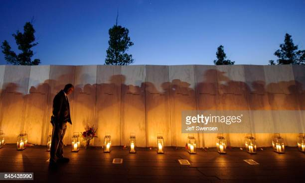 A man pauses before a name on the wall during the Flight 93 National MemorialÕs annual Luminaria on the eve of 16th Anniversary ceremony of the...