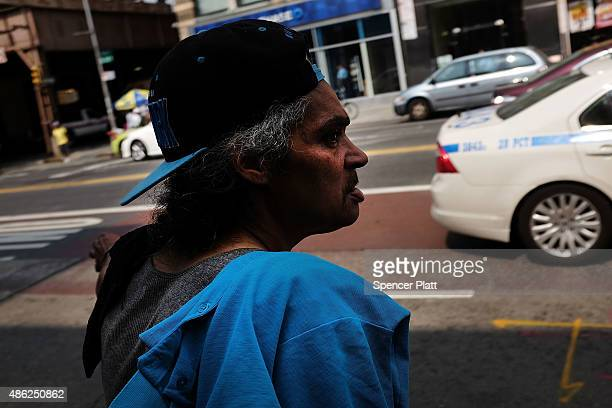 A man pauses in an area which has witnessed an explosion in the use of K2 or 'Spice' a synthetic marijuana drug in East Harlem on September 02 2015...