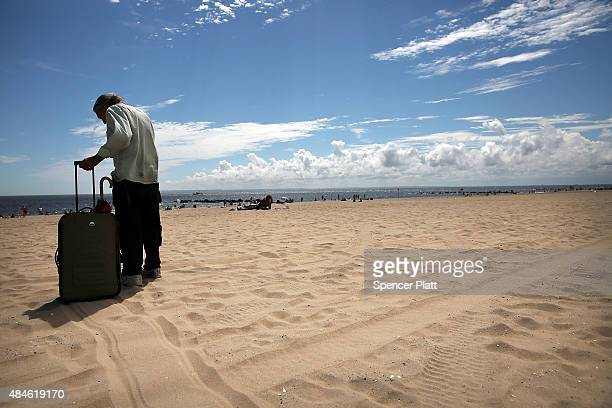 A man pauses in the heat and sand at Brighton Beach in Brooklyn on August 20 2015 in New York City The National Oceanic and Atmospheric...