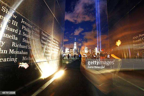 A man pauses inside the Liberty State park 9/11 memorial as The Tribute in Light shines over the New York Skyline on September 11 2015 in Jersey City...