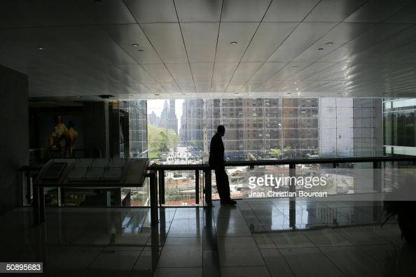 A man pauses on the third floor facing East of the new Time Warner Building in Columbus Circle April 29 2004 in the Manhattan borough of New York...