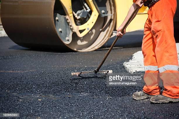 A man paving asphalt on the street