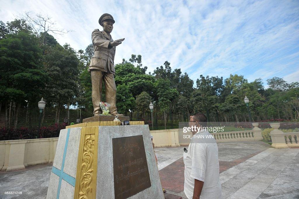 A man pay hid respects to late General <a gi-track='captionPersonalityLinkClicked' href=/galleries/search?phrase=Aung+San&family=editorial&specificpeople=812845 ng-click='$event.stopPropagation()'>Aung San</a> statue to mark the 100th birthday of independence hero <a gi-track='captionPersonalityLinkClicked' href=/galleries/search?phrase=Aung+San&family=editorial&specificpeople=812845 ng-click='$event.stopPropagation()'>Aung San</a>, in Yangon on February 13, 2015. Known affectionately as 'Bogyoke', or General, <a gi-track='captionPersonalityLinkClicked' href=/galleries/search?phrase=Aung+San&family=editorial&specificpeople=812845 ng-click='$event.stopPropagation()'>Aung San</a> is adored in Myanmar and credited with unshackling the country from colonial rule and embracing its ethnic minorities in a vision of unity that unraveled catastrophically in the military-dominated decades that followed his 1947 assassination.