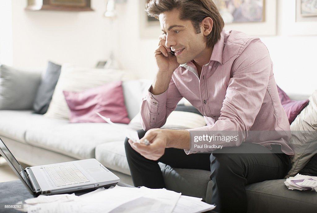 Man paying bills at home : Stock Photo