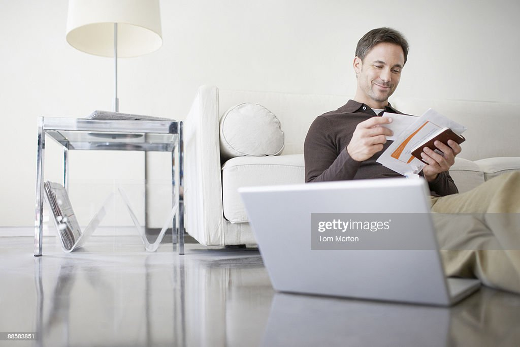 Man paying bills at home : Stock Photo