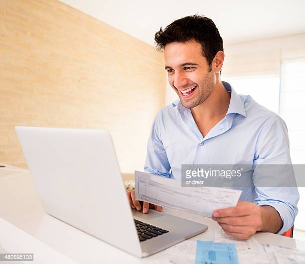 Man paying bills online
