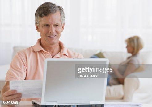 Man paying bills online : Stock Photo