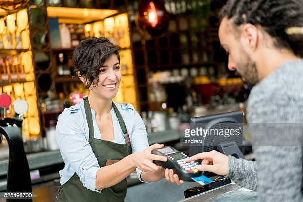 Man paying by card at a restaurant