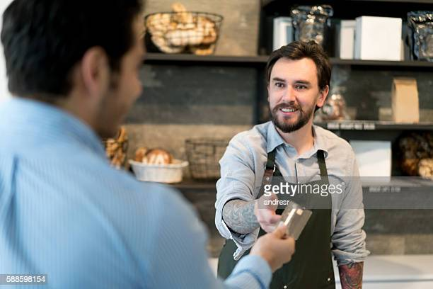 Man paying by card at the bakery
