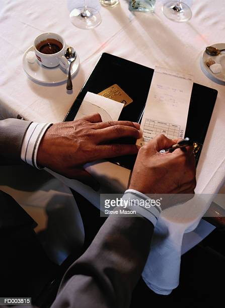 Man paying restaurant check, elevated view, close-up