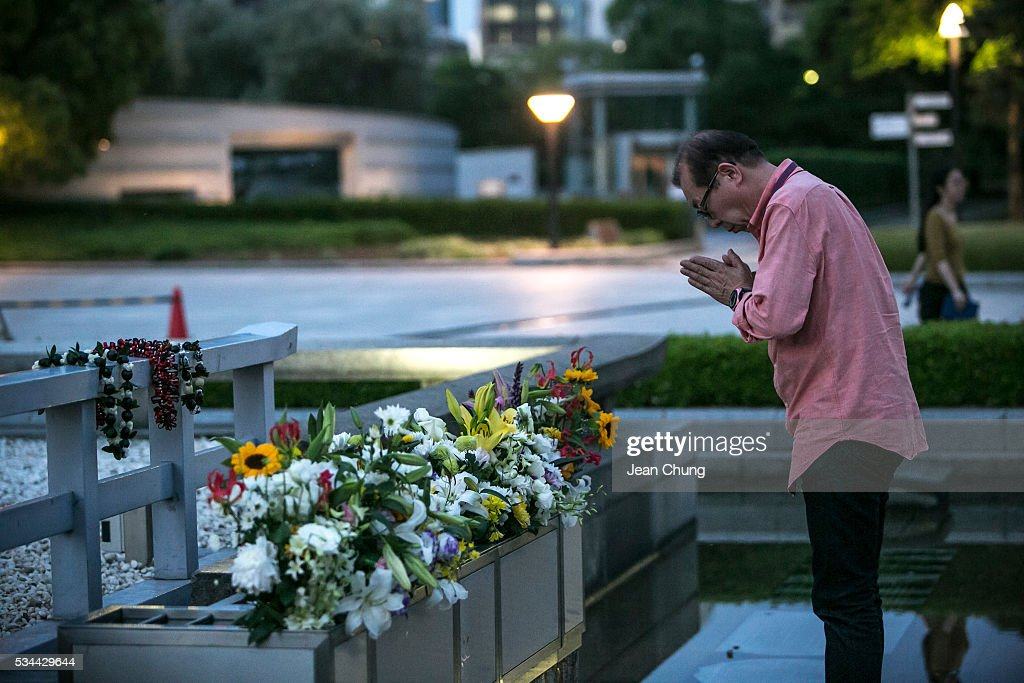 A man pays respects at the arch inside Peace Memorial Park on May 26, 2016 in Hiroshima, Japan. On May 27, President Barack Obama is scheduled to visit Hiroshima, which will be the first time a U.S. president makes an official visit to the site where an atomic bomb was dropped at the end of World War II.