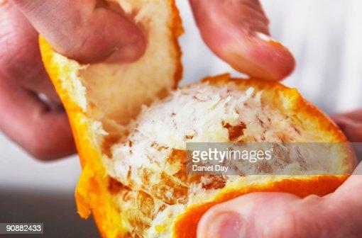 Man pealing fruit : Stock Photo