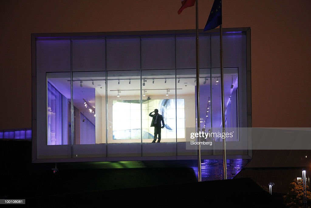 A man peeks out from the Ireland Pavilion at the 2010 World Expo site in Shanghai, China, on Thursday, May 20, 2010. The 2010 World Expo will take place until October 31. Photographer: Qilai Shen/Bloomberg via Getty Images