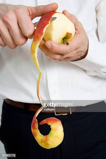 A man peeling an apple
