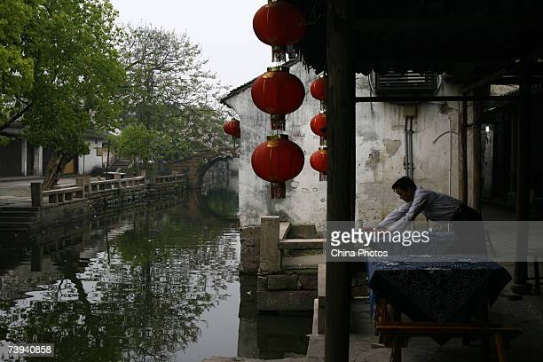 A man pepares a table cloth for tourists at a restaurant during the 12th China Zhouzhuang International Tourism Festival on April 21 2007 in Kunshan...