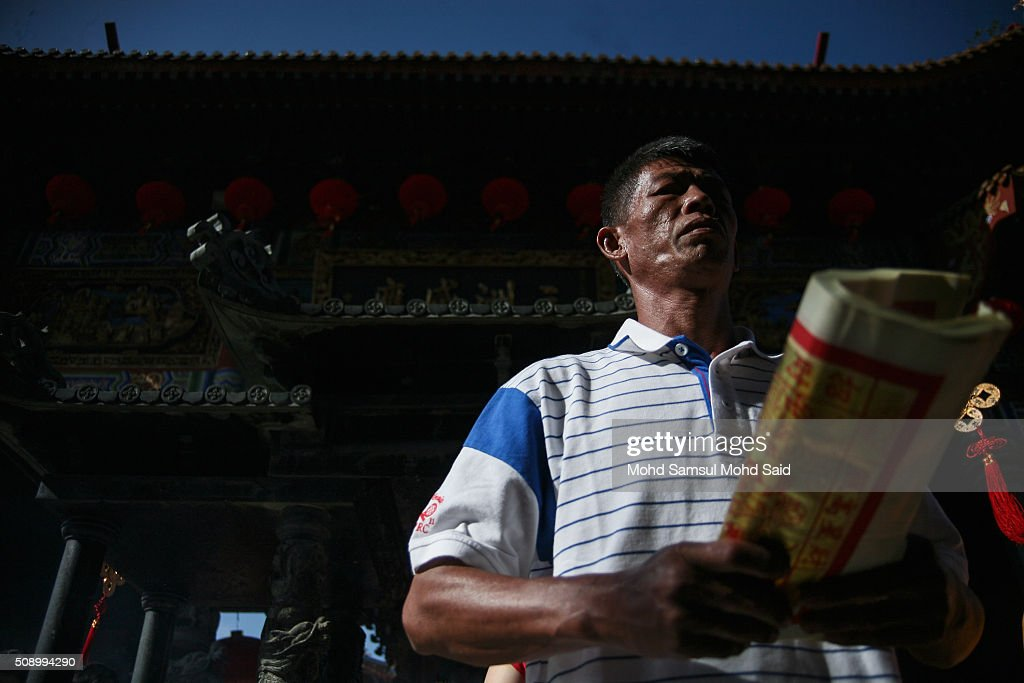 A man perform a prayer inside the Guan Yin temple during Lunar New Year of the monkey celebrations on February 8, 2016 outside Kuala Lumpur, Malaysia. According to the Chinese Calendar, the Lunar New Year which falls on February 8 this year marks the Year of the Monkey, the Chinese Lunar New Year also known as the Spring Festival is celebrated from the first day of the first month of the lunar year and ends with Lantern Festival on the Fifteenth day.