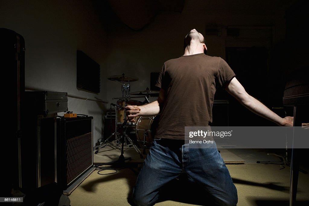 A man performing air guitar