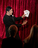 Man performing card trick on stage