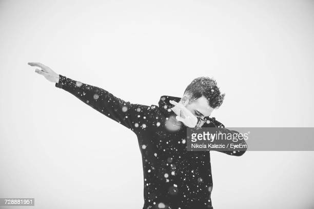 dabb dance. man performing dab dance during winter dabb