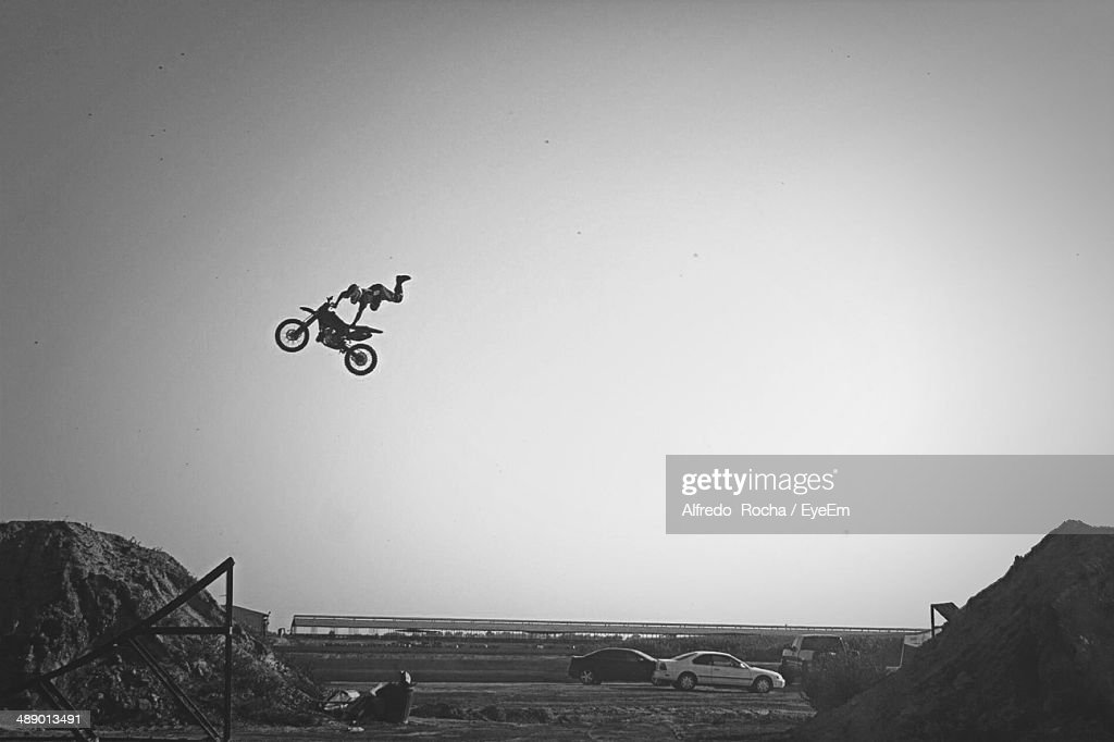 Man performing stunts against clear sky