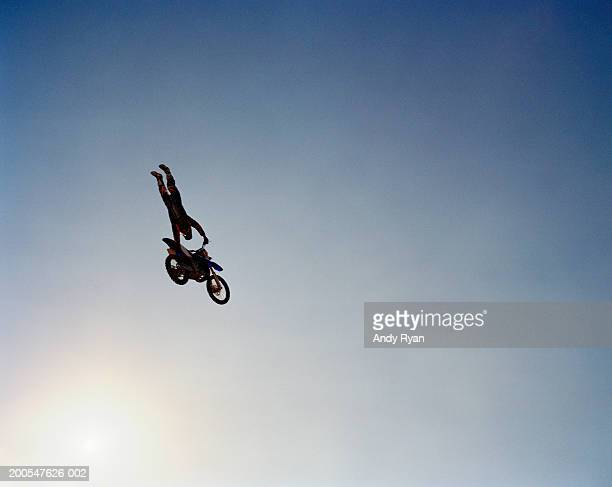 Man performing stunts on motorcycle, low angle view
