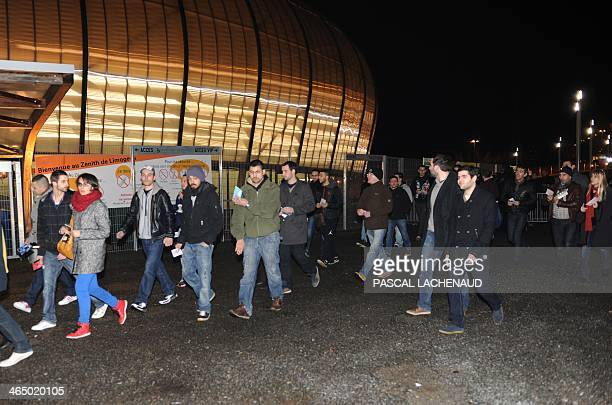 A man performs a 'quenelle' gesture as people arrive at the Zenith theatre in Limoges central France on January 25 for a controversial French...