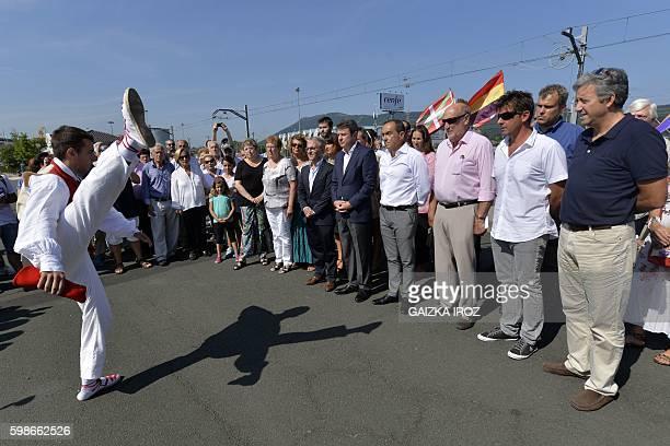 A man performs an 'Aurresku' a Basque honorary dance in front of mayor of Hendaye Kotte Ecenarro mayor of Irun Jose Antonio Santao Clavero and other...