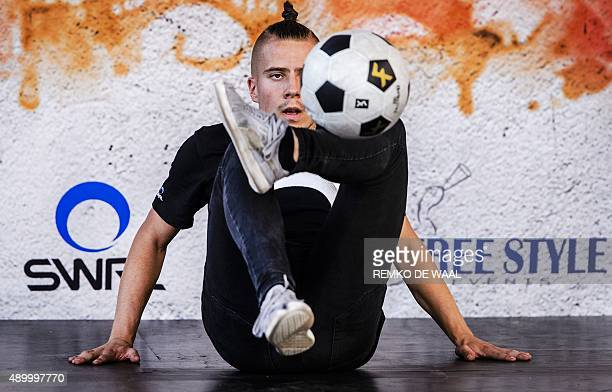 A man performs during the European football freestyle championship on September 25 2015 in Amsterdam AFP PHOTO / ANP / REMKO DE WAAL ==NETHERLANDS...