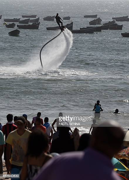A man performs on a waterpropelled flyboard on Sidi Bouzid Beach on August 16 2014 in the Moroccan port city of El Jadida