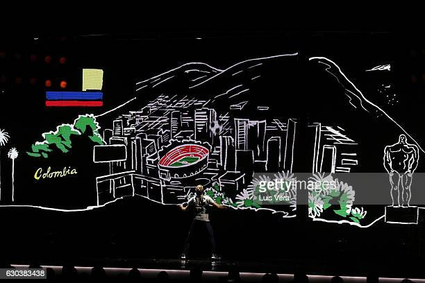 A man performs while the new logo of the Copa Bridgestone Libertadores is unveiled during the during the Copa Libertadores 2017 Official Draw at...