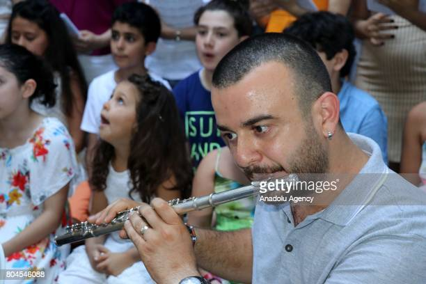 A man performs with a sideblown flute during the Feast of Saints Peter and Paul at Batiayaz Armenian Church in Antakya Turkey on June 30 2017 An...