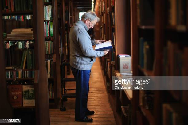 A man peruses books inside one of the many HayonWye bookshops during the Hay Festival on May 31 2011 in HayonWye Wales The small Welsh town is famous...