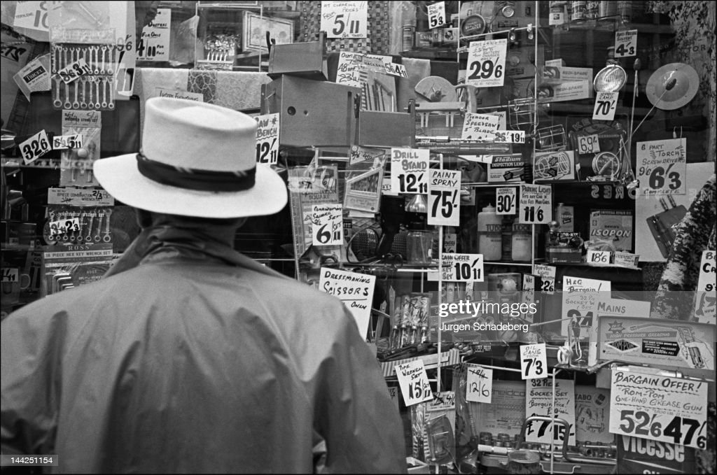 A man peruses the items in the window of an electrical store in Soho, London, circa 1965.