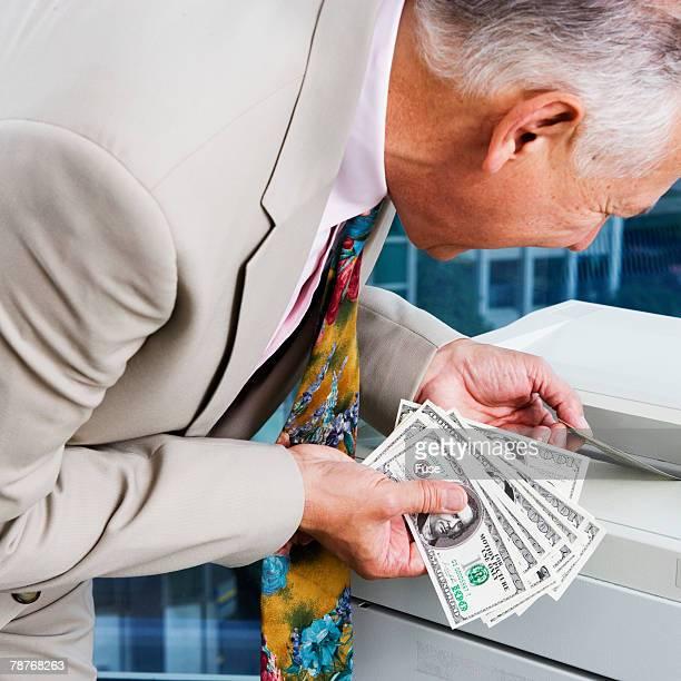 Man Photocopying Dollar Bills