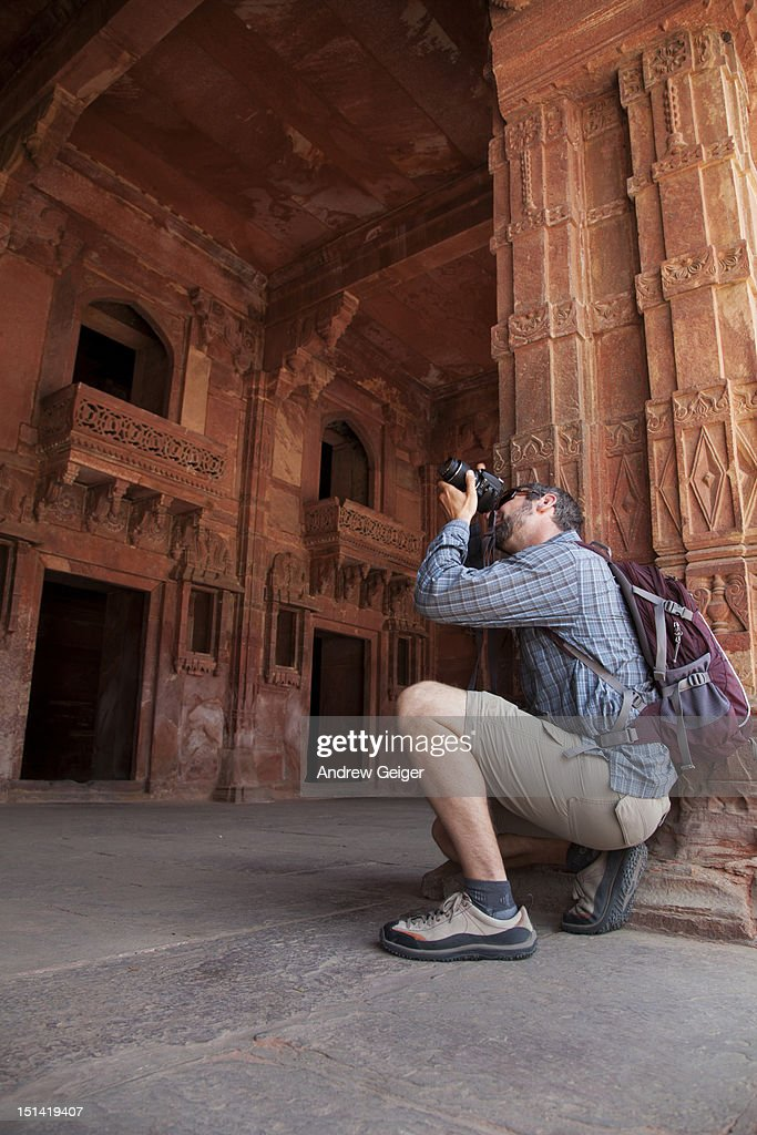 Man photographing ancient building. : Stock Photo