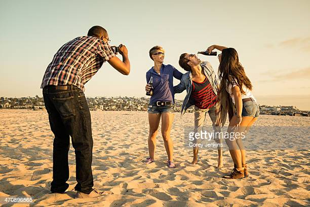 Man photographing friends on Mission Beach, San Diego, California, USA