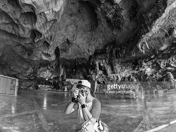 Man Photographing In Cave