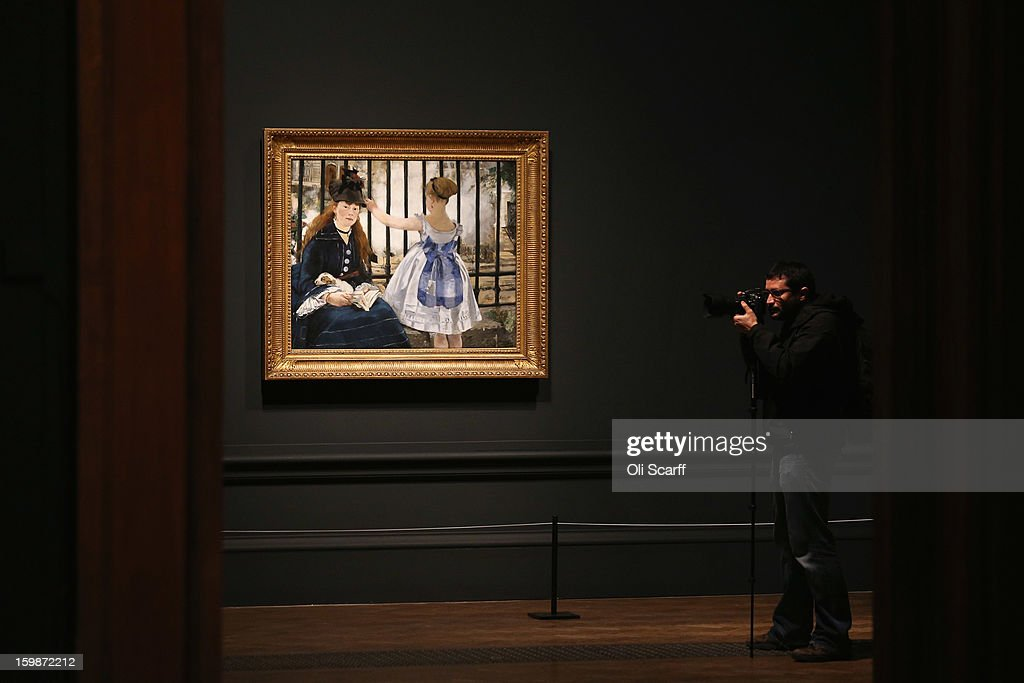 A man photographs a painting by Edouard Manet entitled 'The Railway' in the Royal Academy of Arts on January 22, 2013 in London, England. The painting features in the Royal Academy's new exhibition 'Manet: Portraying Life' which displays over 50 paintings spanning his career. The exhibition open to the general public on January 26, 2013 and runs until April 14, 2013.