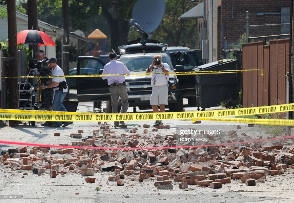 A man photographs bricks that fell from a building during a 54 magnitude earthquake in an alleyway in Pomona California on July 29 2008 A 54...