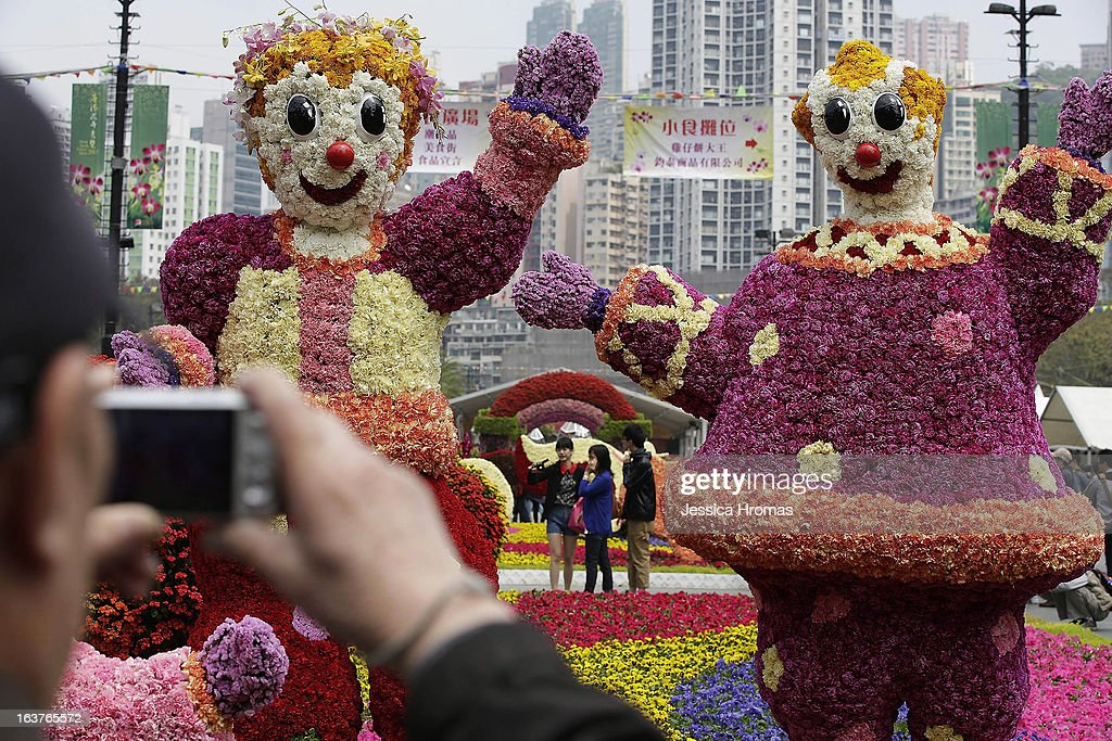 Man photographs flower figures at the 2013 Hong Kong Flower Show at Victoria Park on March 15, 2013 in Hong Kong, Hong Kong. The 2013 Hong Kong Flower Show opened today and will continue until March 24, 2013.