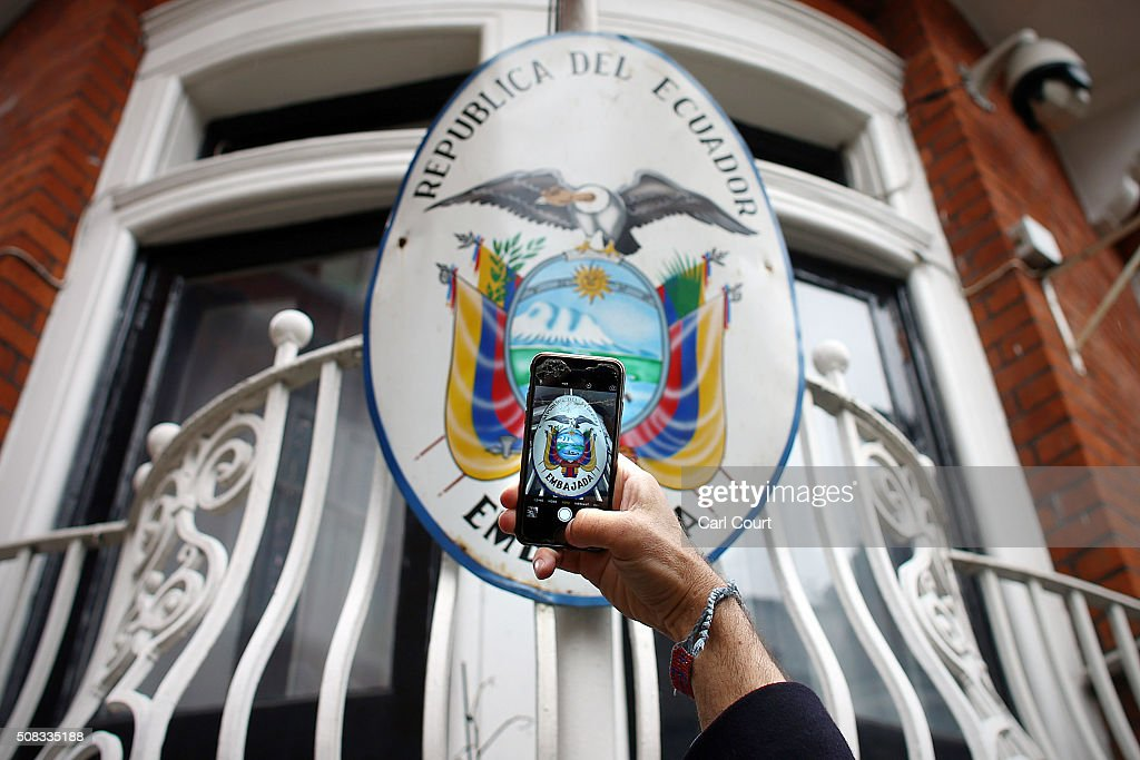A man photographs the sign on the balcony of the Ecuadorian embassy where Wikileaks founder Julian Assange continues to seek asylum following an extradition request from Sweden in 2012, on February 4, 2016 in London, England. It is understood that a United Nations panel has ruled in favour of Wikileaks founder Julian Assange following complaints he was being arbitrarily detained.