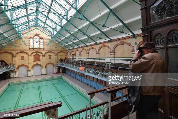 A man photographs Victoria Baths which are opening today for the first time in over 20 years for a one off public swimming event on May 14 2017 in...