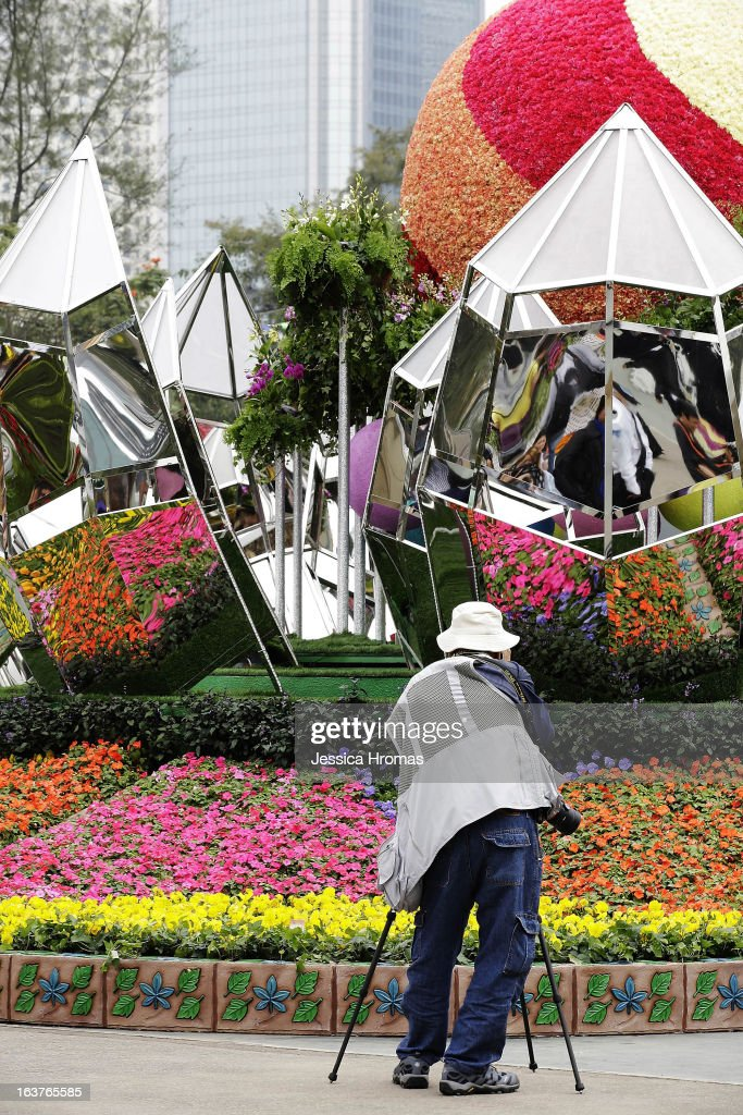 A man photograps a flower display with mirrors at the 2013 Hong Kong Flower Show at Victoria Park on March 15, 2013 in Hong Kong, Hong Kong. The 2013 Hong Kong Flower Show opened today and will continue until March 24, 2013.