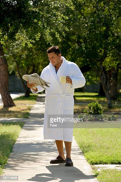 Man Picking Up the Morning Paper in His Bathrobe