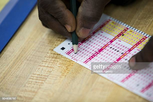 A man picks his numbers with hopes of winning the record $15 billion Powerball jackpot at a convenience store in Gaithersburg Md USA on January 13...